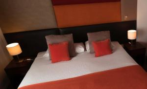 A bed or beds in a room at Rochester Calafate