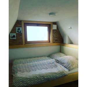 A bed or beds in a room at Apartments Beeland Skok