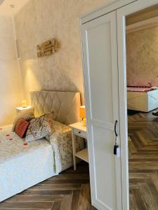 A bed or beds in a room at B&B Blu Infinito