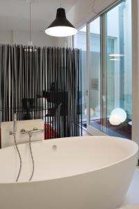 Ein Badezimmer in der Unterkunft Leopold5 Luxe-Design Apartment