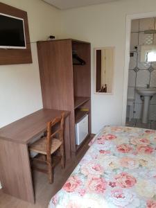 Cama ou camas em um quarto em Pousada da Baronesa