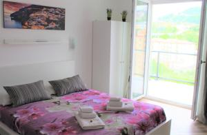 A bed or beds in a room at Apartment in Salerno Parco