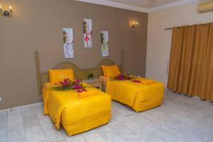 A bed or beds in a room at Ocean Villa Heights