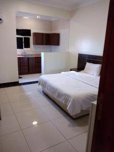 Cama ou camas em um quarto em OYO 481 Mersal