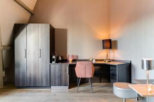 A kitchen or kitchenette at Brasss Hotel Suites