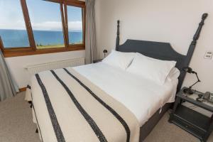 Cama o camas de una habitación en Casa Molino Hotel Boutique
