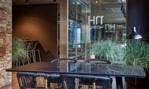 Un restaurante o sitio para comer en NH Andorra la Vella