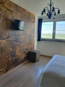 Телевизор и/или развлекательный центр в B&B Kanegem Onverbloemd