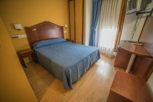 Cama o camas de una habitación en Hotel las Cruces