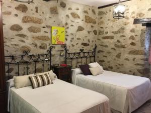 Cama o camas de una habitación en Casa Rural La Antigua Tahona