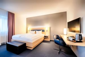 A bed or beds in a room at Hotel Sachsen-Anhalt