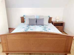 Łóżko lub łóżka w pokoju w obiekcie Dom Aptekarza