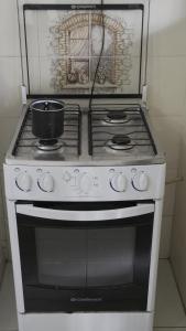 A cozinha ou cozinha compacta de Casa Itaguá