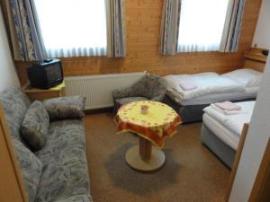 Ein Sitzbereich in der Unterkunft Pension Barbara