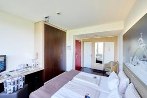 A bed or beds in a room at Hotel Oversum Winterberg Ski- und Vital Resort