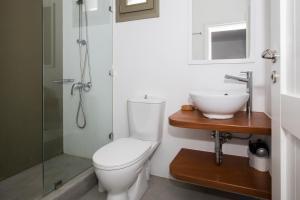 A bathroom at Petradi Studios & Villa
