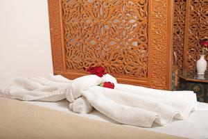 A bed or beds in a room at Riad Daria Suites & Spa