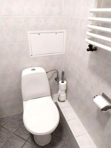 A bathroom at Color Apartment 2