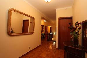 A television and/or entertainment center at Residencial Sra. da Lomba