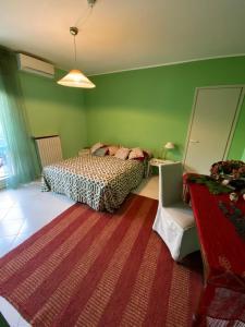 Letto o letti in una camera di B&B La Villa