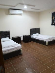 Cama ou camas em um quarto em OYO 519 Ranan Hotel Apartments