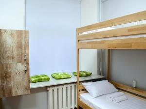 A bunk bed or bunk beds in a room at Hostel51