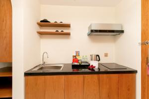 A kitchen or kitchenette at Maple Suite Hotel & Apartment