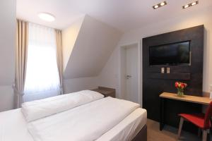 A bed or beds in a room at City Hotel Würzburg
