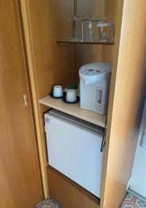 A kitchen or kitchenette at Hotel Nikko Tsukuba
