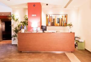 Ο χώρος του λόμπι ή της ρεσεψιόν στο Astros Beach Boutique Hotel