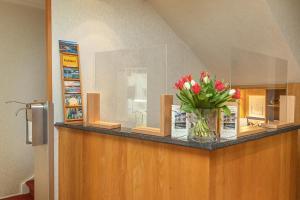 De lobby of receptie bij Hotel Brenner