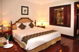 A bed or beds in a room at Saigon Morin Hotel