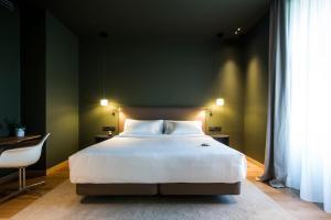 Cama o camas de una habitación en Hotel Arbaso