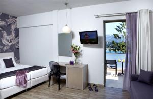 TV o dispositivi per l'intrattenimento presso Mouikis Hotel Kefalonia