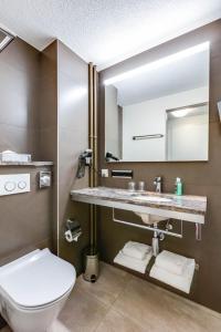 Ein Badezimmer in der Unterkunft Alexander Guesthouse Zurich Old Town