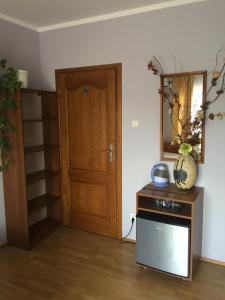 Televízia a/alebo spoločenská miestnosť v ubytovaní Pensjonat Przy Błoniach