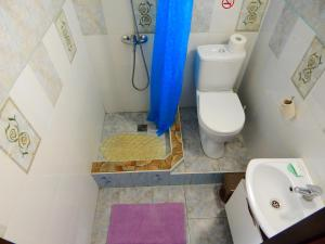 Ванная комната в Apartment-studio Royal Forest
