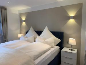 Ein Bett oder Betten in einem Zimmer der Unterkunft Ferienwohnungen Köhnke