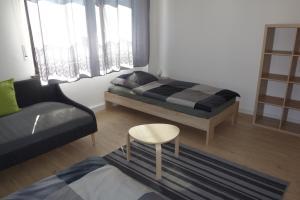 A bed or beds in a room at Ferienwohnungen Viersen