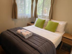 A bed or beds in a room at BIG4 NRMA Atherton Tablelands Holiday Park