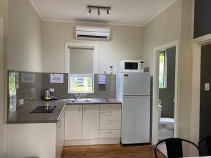 A kitchen or kitchenette at BIG4 NRMA Atherton Tablelands Holiday Park