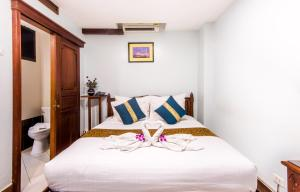 A bed or beds in a room at Family Boutique Hotel