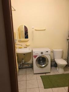 A bathroom at Уютная однушка в самом сердце Центрального района
