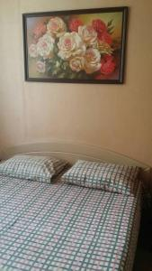 A bed or beds in a room at Лабиринт