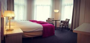 Een bed of bedden in een kamer bij Hotel Wesseling