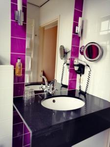 Een badkamer bij Hotel Wesseling