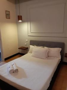 A bed or beds in a room at Sole Hotel