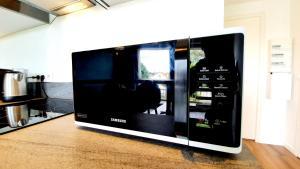 A television and/or entertainment centre at Le nid douillet d'Angèlique et David