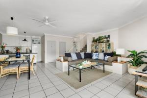 """A seating area at Belle Escapes - Poolside Apartment Alamanda Beachfront Resort """"56"""""""