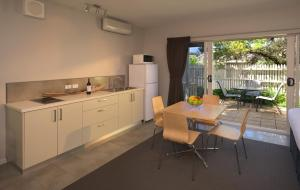 A kitchen or kitchenette at Boathouse Resort Studios and Suites